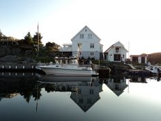 white house with boats on Feøy, Karmøy, Norway