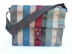 what a cool idea! recycling seat belts, I love these bags and purses. as cool in person as they look online!