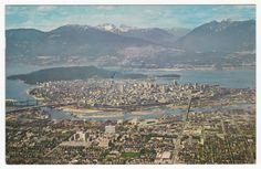Aerial of Downtown Vancouver, British Columbia, the Harbour & the Mountains.
