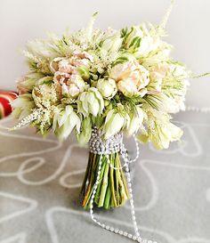 A feminine parrot tulip wedding bouquet.