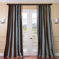 Add a modern and stylish touch to your home with this stripe curtain panel. With blue and chocolate stripes, this window panel is made of 100 percent polyester and features a cotton lining and heavy flannel interlining.