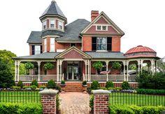 Victorian with wrap-around veranda and attached gazebo.
