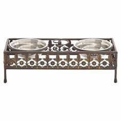 """Too small for my dogs, but lovely!!! Bring chic style to mealtimes with this lovely metal pet diner, featuring 2 bowls and an openwork design in brown.  Product: 2 Pet bowls and 1 standConstruction Material: MetalColor: Steel and rustic brownFeatures:  Includes two bowlsStand has a distressed finishDimensions: 5"""" H x 15"""" W x 6"""" D (overall)"""