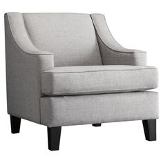 Showcasing swoop arms and crisp linen upholstery, this poplar wood-framed accent chair is a sophisticated addition to your den or living room seating group.