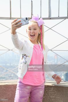 Jojo Siwa Visits The Empire State Building To Promote Her Tv Special Jojo Siwa My World Stock Pictures, Royalty-free Photos & Images Jojo Siwa's Phone Number, Dance Mums, Jojo Bows, World Photo, Halloween Costumes For Girls, Empire State Building, Ballet, Real Phone, Dancer