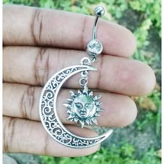 Half hallow moon and sun 14 gauge stainless steel dangle belly button... ($8) ❤ liked on Polyvore featuring jewelry, button jewelry, stainless steel jewellery, stainless steel jewelry, body jewellery and body jewelry