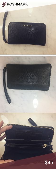 Cole Haan black leather wallet Perfect condition, black leather Cole Haan wallet, navy cloth interior, gold hardware, a classic, wrist strap Cole Haan Bags Wallets