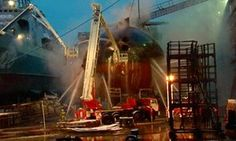 Firefighters spray water on the Yekaterinburg nuclear submarineDecember 29, 2011 K-84 nuclear submarine incident,