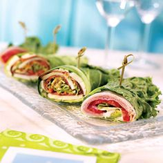 California Wrap -This is a great take-along snack. Prepare it the night before and wrap tightly in plastic wrap to keep fresh for the next day. Ingredients: 1 red or green leaf lettuce leaf, 1 slice low sodium deli-style turkey, 1 slice low-fat thinly sliced deli-style ham, 1 thinly sliced tomato, 1/8 thinly slice whole avocado, 1 tsp lime juice, 1 leaf watercress or arugula, 1 tbsp sugar-free ranch dressing, 1 whole toothpick. Fan the lettuce leaf on a plate. Top w/ the turkey, ham…