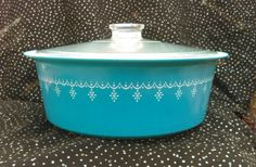 Check out this item in my Etsy shop https://www.etsy.com/listing/279705294/1970s-4qt-pyrex-blue-snowflake-round