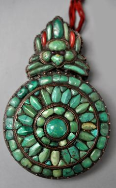 """From the current available inventory of noted dealer Linda Pastorino. Check out her pages. THE best pieces available on the market today! Very rare and early """"moon eater ornament"""" turquoise, coral and small ruby eyes. 17th/ 18th c (info@singkiang.com)"""