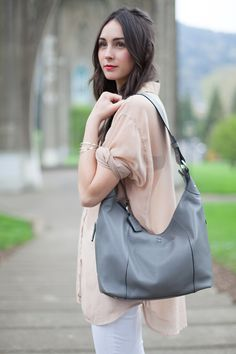 Contrast is key. The Ellington Alex Hobo in gray Italian leather with black detailing transitions beautifully from season to season. A chic must-have for any wardrobe.
