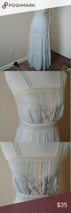 """Western vibes Vintage prairie dress Charming vintage baby blue prairie dress with off white lace. Zip closure and ties in the back. Cotton/poly blend. Candi Jones. Needs a good cleaning.  Bust 33.5"""" Waist 25.5"""" Hips 40""""- 42"""" Length 53""""  #vintage #dress #prairie #boho #maxi #baby #blue Vintage Dresses Maxi"""