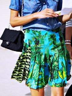 Pair a totally rad fashion-forward pleated skirt in a tropical print with cool separates like a denim shirt and mini-bag. // #StreetStyle