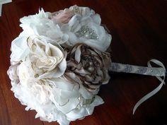 love love LOVE this bouquet from a weddingbee poster...wishuponastar84...who can make this for me??