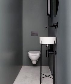 Pros: Layout works for a tiny bathroom. Sink is cute and would fit in a really small space. Cons: Walls are too dark and there are no warm elements in the space.