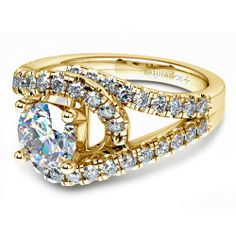 It's a wrap: Meet the Split Shank Diamond Wrap Engagement Ring in classic Yellow Gold, featuring a Round-cut center diamond. The warm metal hue brings out diamond sparkle beautifully!  http://www.brilliance.com/engagement-rings/split-shank-diamond-wrap-ring-yellow-gold