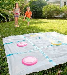 Outside tic tac toe with frisbees. Place X with tape on half and leave the others as is for the O's.  Use an old sheet, place tape for the sections...