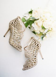 Gold cage Jimmy Choo stilettos: Photography : Sylvie Gil Photography Read More on SMP: http://www.stylemepretty.com/2017/03/08/glam-napa-valley-vineyard-wedding/