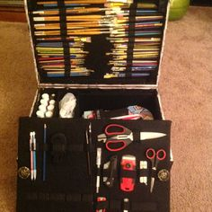 A retrofitted suitcase for organizing art supplies for my bride to be!
