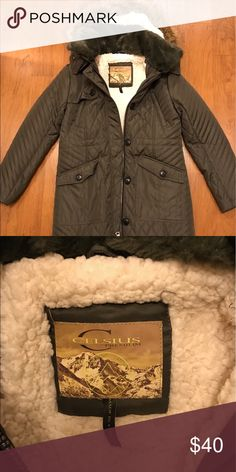 Brand New Celsius Premium Coat Brand New! Decided not to keep it because the sleeves were too short for me. Long green coat with fur hood. Celsius Jackets & Coats