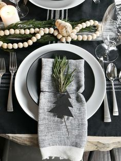 Easily recreate this Scandinavian Inspired Christmas Tablescape using simple pieces and incorporating a lot of texture through greenery and wooden beads. Click the link for the full list of products used in the tables cape.