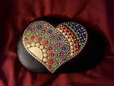 First attempt at a This is going to be my new obsession lol Rock Painting Patterns, Dot Art Painting, Rock Painting Designs, Mandala Painting, Pebble Painting, Pebble Art, Stone Painting, Mandala Painted Rocks, Mandala Rocks