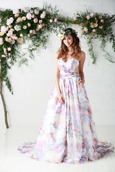 'Bloom', RRP £1,620  Bloom is a unique purple floral print covering this sweetheart neckline gown with ruched waist sash & pocket detail.  Bloom makes up the trio of floral gowns Perfect floral wedding dress.