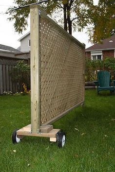 Decorative, movable privacy screen. Attach large planter box with climbing flowers. -- for the non fenced section between my driveway and neighbours. Drives M crazy that they keep using our land as their own. Not cool to look out your window and see strangers wandering in your yard.