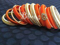 <3 love this orange bangles