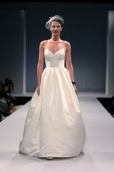 Sophie from Anne Barge Fall 2013 Bridal Collection may seem too simple for some but yet, in my opinion, makes quite a style statement. In such display of sleek elegance from the long spaghetti strap with midriff inset of satin stripe silk shantung and full gathered skirt, this gown is a modern take to a classic for today's sophisticated bride. Like my personality (ahem…), the gown evokes a certain quiet confidence and simply let the bride shine!