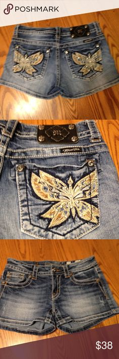 Miss Me Shorts Pre loved  Miss Me shorts with embroidered butterfly's with rhinestone accents  on back pockets. Size 27. Low rise, distressed wash. 98%Cotton 2%Spandex Miss Me Shorts Jean Shorts