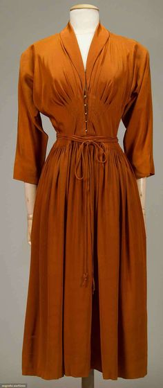 McCARDELL BURNT ORANGE SILK DRESS, 1949 V neck, long dolman sleeves, CF brass hook closures, self-fabric cord-tie belt