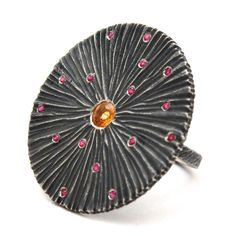 This head turner features #orange and #pink sapphires in oxidized sterling silver. The beauty of oxidized silver? You never have to polish it! #ecofashion