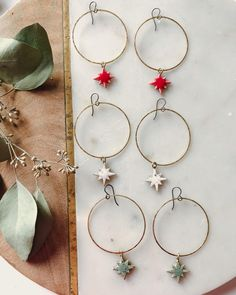 These handmade starburst hoop earrings will be available in my holiday update (November 27th!). Hoop earrings are paired with a variety of colored starburst ceramic charms. Add the perfect amount of sparkle and shine to your holiday outfits.