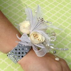 Bring out her inner Princess!  Floral Jewelry is Super Hot this Prom Season.  Flowers of Charlotte will design a one of a kind Corsage with all the bling to match your Prom dress!  Find us at www.flowersofcharlotte.com