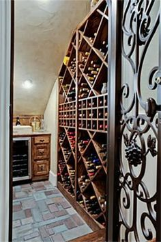 under the stairs coat closet becomes wine cellar