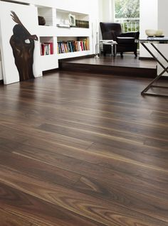 The beautiful walnut effect flooring is made up of extra wide planks that are detailed with a wood grain design for an authentic look. Get 20 years domestic warranty when you order the Kronospan Vario Plus rich walnut laminate flooring with flooringsupplies.co.uk.