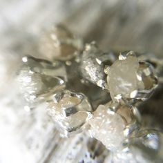 Loving these shades of gray! Piled up raw diamond studs...