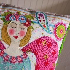 An appliqué cushion by me lucy Levenson designs www.lucylevenson.com