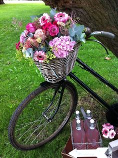 Pretty flowers in a basket on a bike