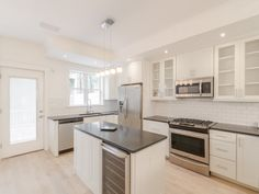 Kitchen featuring subway tiles from CliqStudios