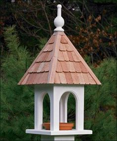 """Lazy Hill Loretta Feeder - Inviting beaded arch opening. White vinyl house with natural color shingles. 23"""" H. 11"""" sq."""