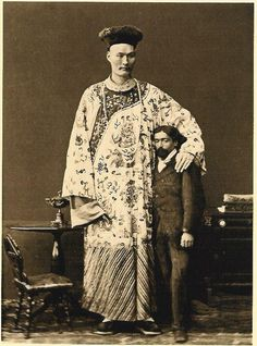 Somewhat friendly Chinese giant c1880s. This is probably Chang, or Chang-woo-woo, who was 8ft. 2in. tall.