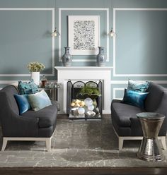 """This room owes its polished air to perfect symmetry — pairs of sofas, vases and pendants result in a calming and sophisticated space. To achieve this look, mimic moulding by creating """"panels"""" with tape before painting the wall and plug in a simple electric fireplace for an instant focal point. Lush velvet pillows and metallic side tables add the right amount of glitz."""
