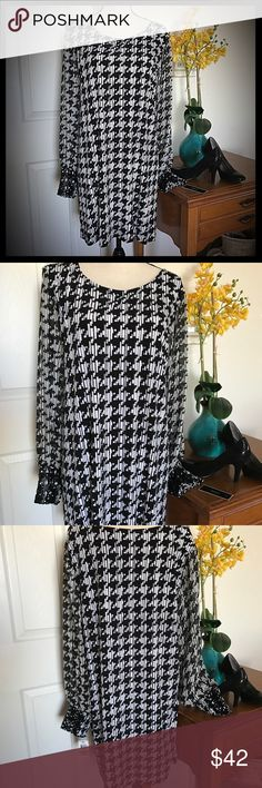 Alfani Black & White Checkered Long Top Dress Alfani plus size 3X long top/dress. New with tags. Gorgeous black and white checkered with faux leather decorative cuffs. Bust measures 25 inches laying flat not doubled and is 34 inches long. Alfani Tops Blouses