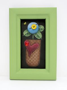 A Single Blue Folk Art Flower Framed in Green Tole Painted