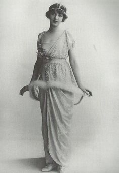 "The actress Ina Claire - dress ""lampshade"" Poiret   The famous dress ""lampshade"" created by Paul Poiret. The circle of fur floating in the hips is supported by a wire to keep away from the body. This circle contrasts with the soft line and draped empire waist dress."