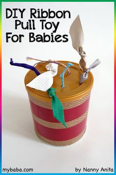 Use an old container (like a formula tin) to make this DIY ribbon pull toy for babies. The ribbon pull toy is a great way for babies to develop their fine motor skills. Diy Montessori Toys, Montessori Toddler, Toddler Toys, Montessori Bedroom, Toddler Stuff, Babies Stuff, Diy Sensory Toys For Babies, Baby Sensory, Sensory Play