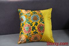 The yellow square 55cm/21'' brocade cushion cover displays the intertwined peony floral patterns called 'Chanzhi' in Chinese, which symbolize the circle of life and endless prosperity.
